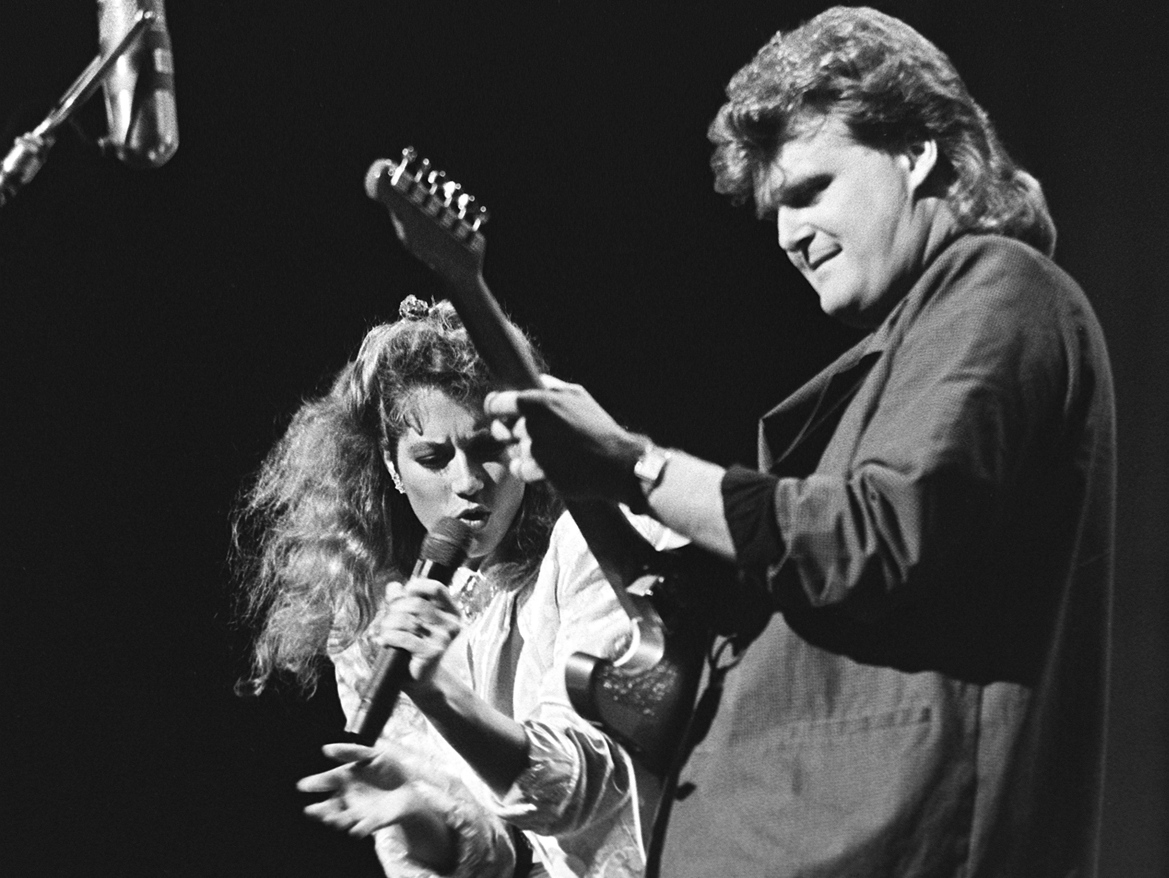 Amy Grant joins Ricky Skaggs during the CMA Awards show at the Grand Ole Opry House in 1986.