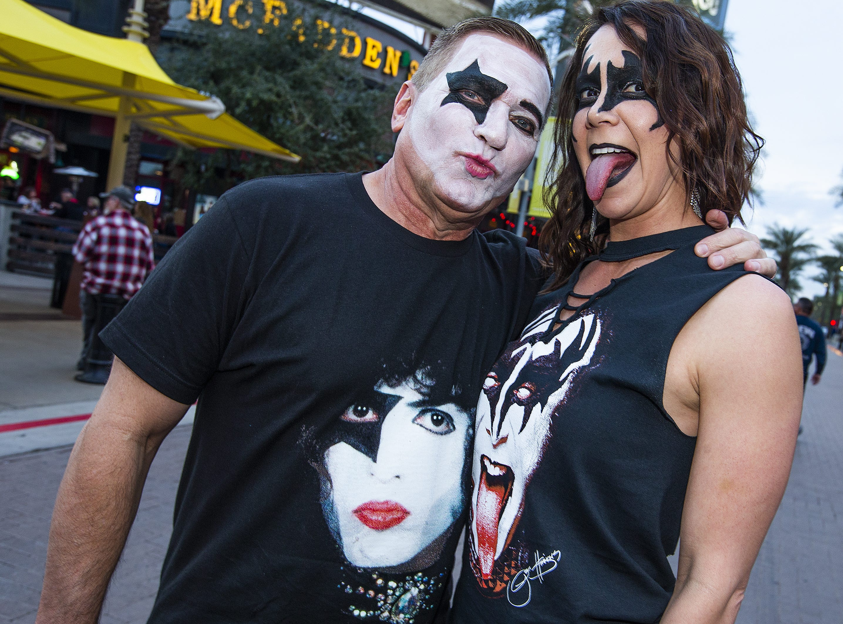 Tucson residents Kirk Stuessel, 56, and his wife, Sandra, 38, show off their best KISS make-up prior to the concert by the famed group at Gila River Arena in Glendale on Wednesday, Feb. 13, 2019.  The concert was part of the End of the Road World Tour, the band's farewell to the fans.