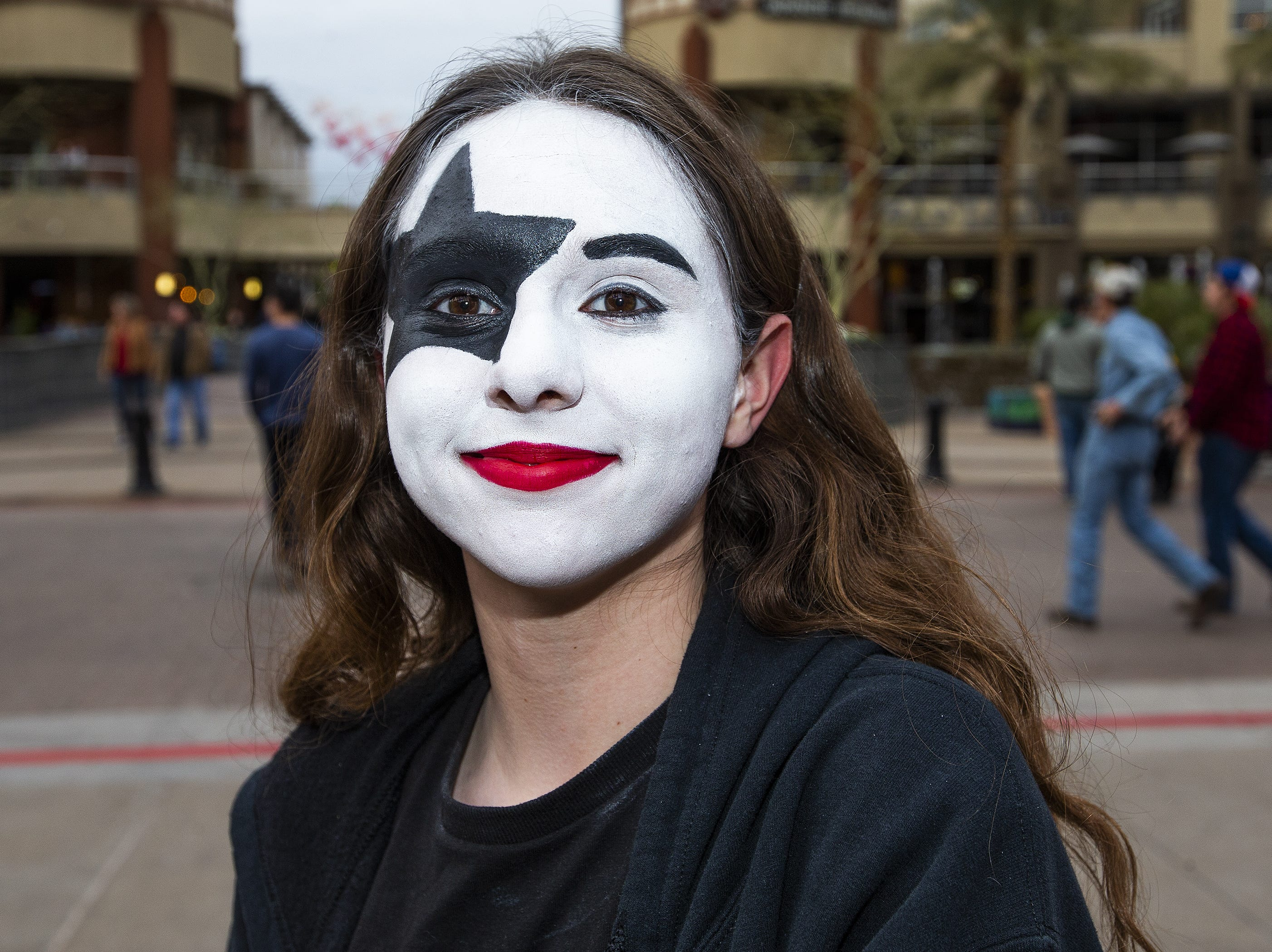 Jeneva Mitchell, 14, of Scottsdale, shows off her best KISS makeup prior to the concert by the famed group at Gila River Arena in Glendale on Wednesday, Feb. 13, 2019. The concert was part of the End of the Road World Tour, the band's farewell to the fans.