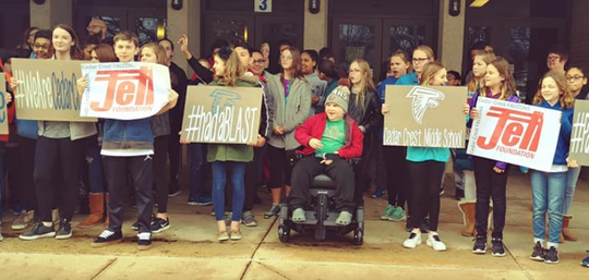 Levi Hains, center, and his classmates at Cedar Crest Middle School celebrate the arrival of a new handicapped-accessible van for Levi, who is battling Duchenne Muscular Dystrophy, on Wednesday.