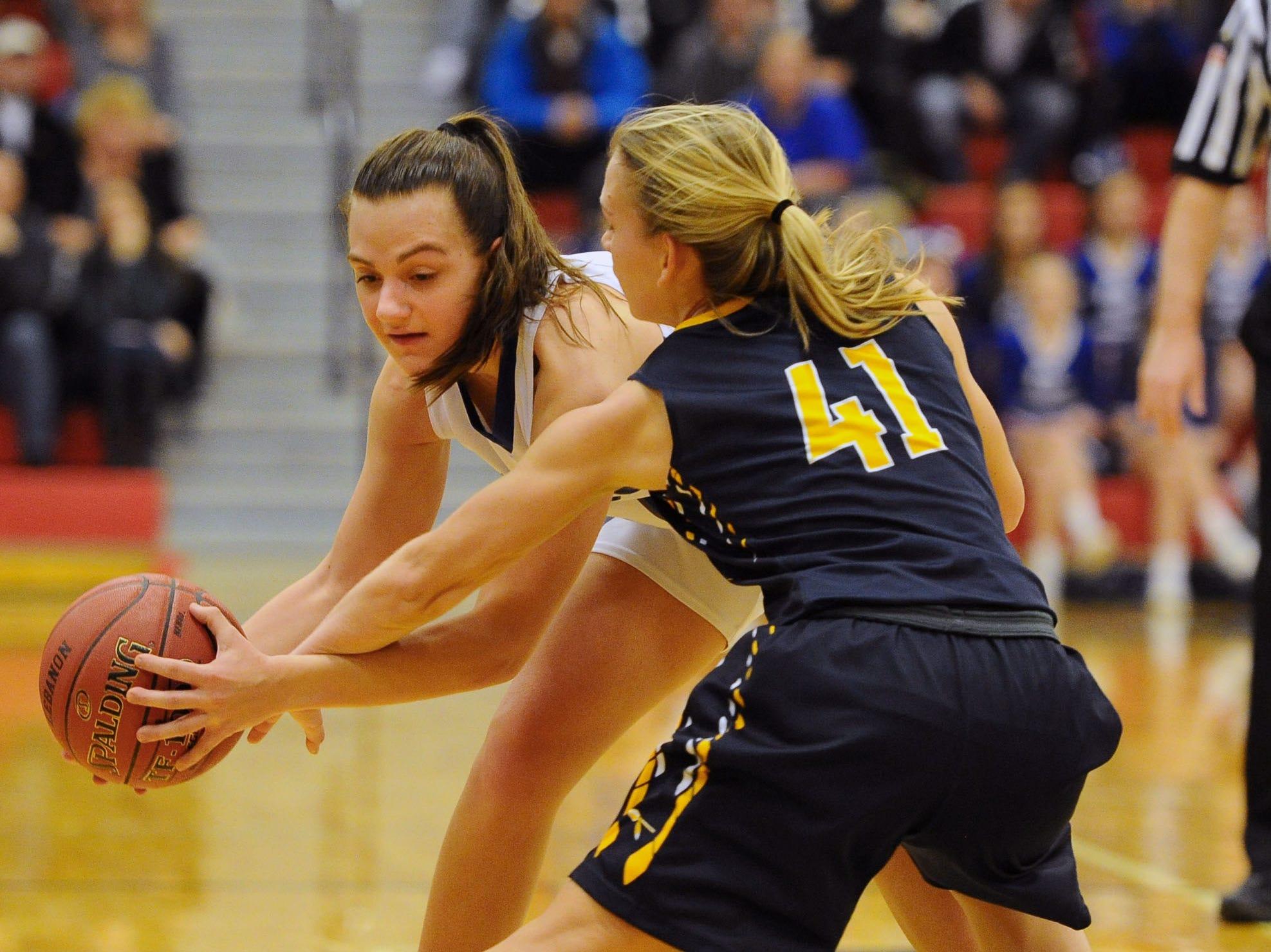 Elco's Julia Nelson (41) puts pressure on Molly Bucher (14) from Cedar Crest.