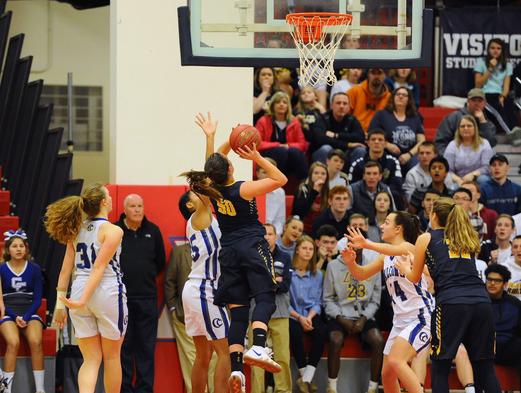 Ryelle Shuey (50) of Elco goes up for two points against a trio of Cedar Crest defenders.