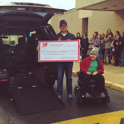 Fundraising efforts result in handicapped accessible van for South Lebanon boy