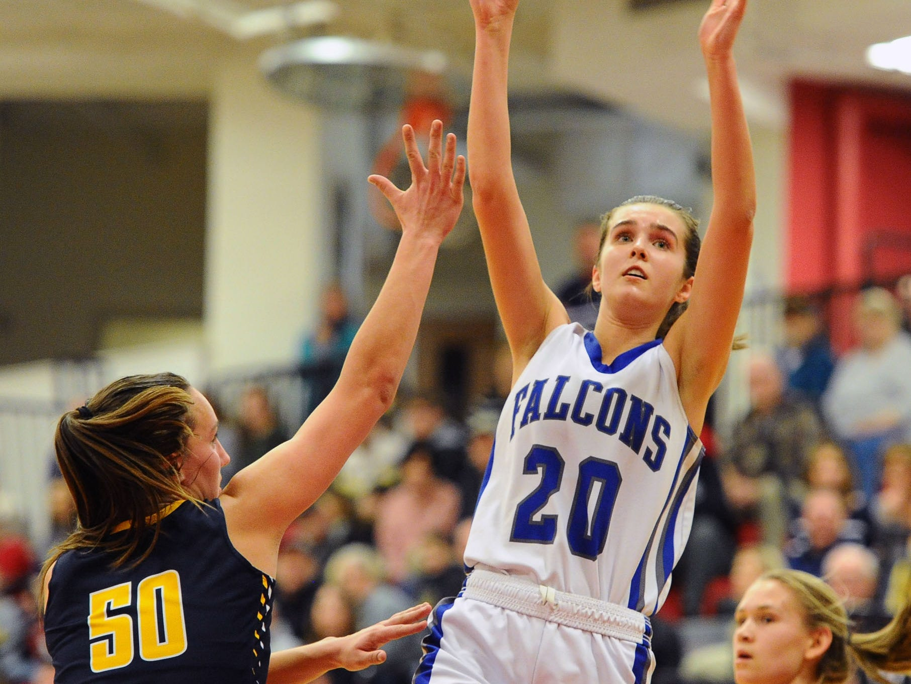 Reese Glover (20) from Cedar Crest shoots over Elco's Ryelle Shuey (50).