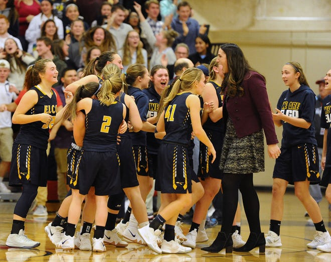 Elco players celebrate with head coach Ashli Shay after their dramatic 36-34 OT win over Cedar Crest in the Lancaster-Lebanon League semifinals on Wednesday night at Lebanon High.