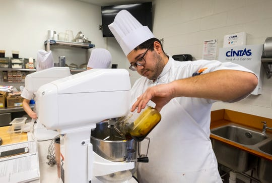Culinary Institute of Michigan student Jordan Willis works on preparing the batter for a pecan pie Wednesday, Feb. 13, 2019 in one of the school's labs. Willis, 18, is a first year student from Flint in the school's baking and pastry program in Port Huron.