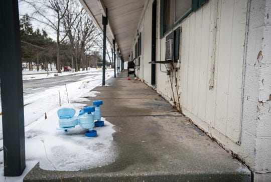 A child's ride-on toy sits in the snow outside of a room Thursday, Feb. 14, 2019 at the Days Inn in Port Huron. The city of Port Huron in a lawsuit filed Thursday began taking steps to shut down the Days Inn property on Pine Grove Avenue, citing a slew of police and public nuisance issues from over the last two years.