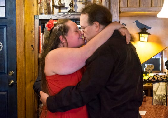 Danielle Spires, left, and Jedidiah Negley, right, are married by the Rev. Pat Thompson Thursday, Feb. 14, 2019 at Raven Cafe in Port Huron.