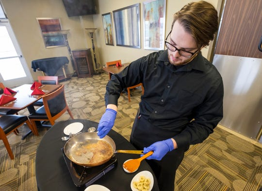 Culinary Institute of Michigan student Alex Womack, 20, makes Bananas Foster Wednesday, Feb. 13, 2019 in the school's restaurant, COURSES. Womack said he hopes to open a restaurant after he graduates, and generally enjoys cooking dishes like hamburgers and steak.