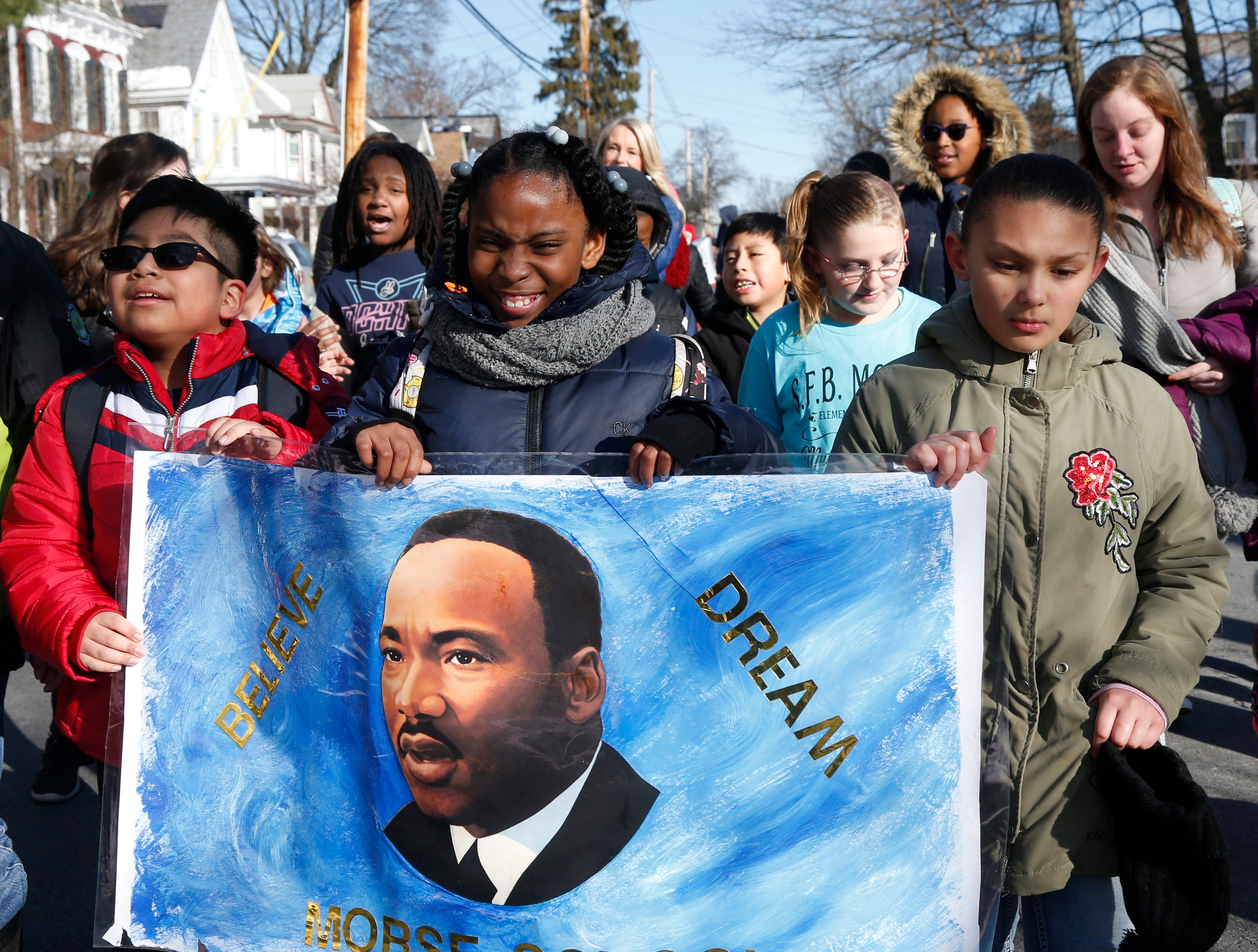 Students from Morse Elementary School, from left, Bradley Vazquez, Shantinae Windett and Brianna Sheldon  participate in Thursday's Martin Luther King Celebration, including a peace walk at Poughkeepsie High School on February 14, 2019.