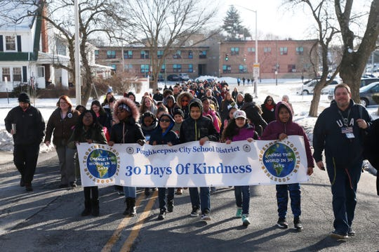 Leading the City of Poughkeepsie school district peace walk as part of Thursday's Martin Luther King Celebration, students from Clinton Elementary School, from left, Kyshina Justus-Gause, Kylee Anglero, Kameron Palmatier, Ian Reyes, Renae Gillette, Leilani Thompson and advisor Mike Smith march along Forbus Street on February 14, 2019.