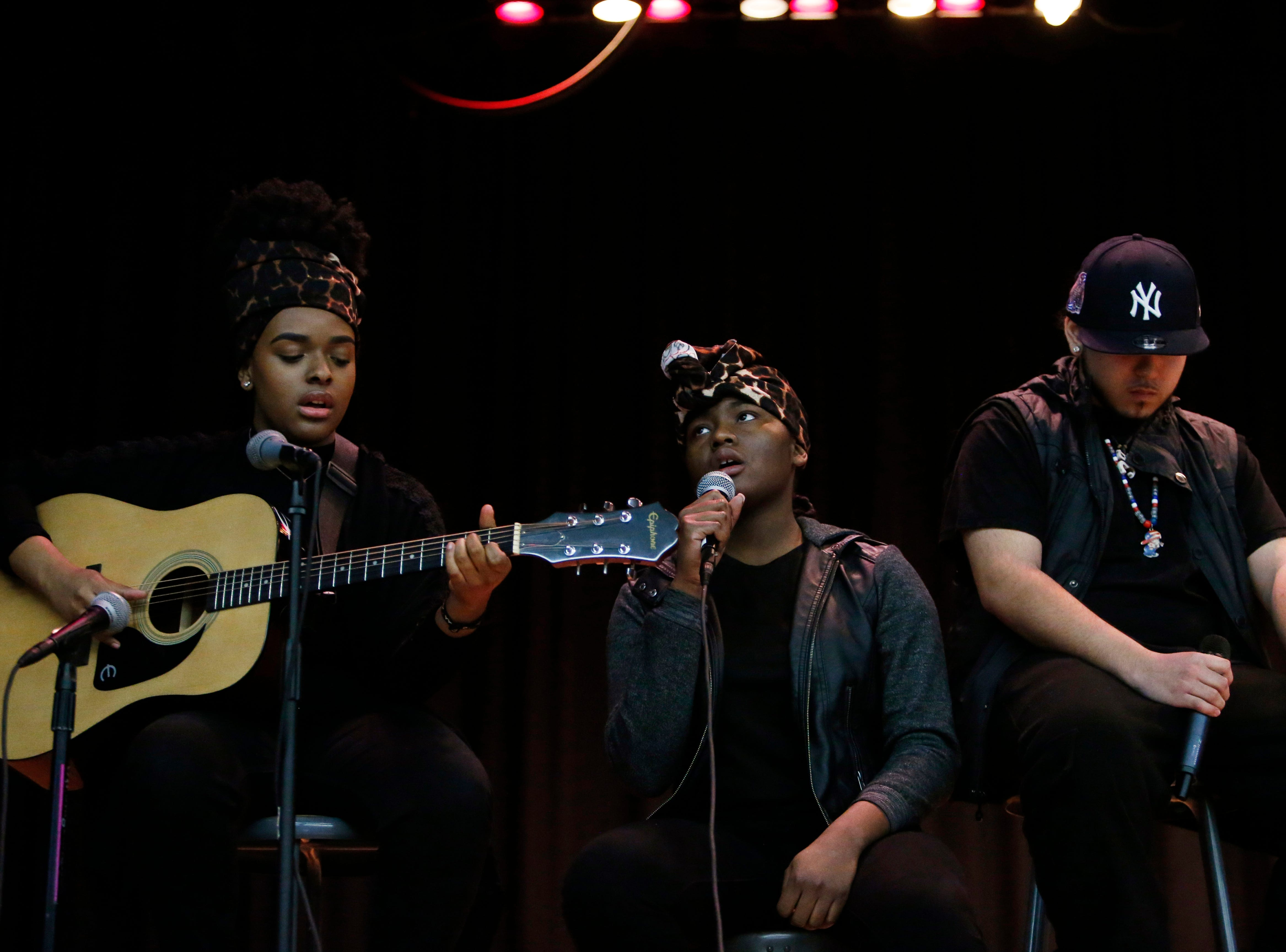 Poughkeepsie High School students, from left,  Angel Hernandez, Taznir Smalls and Miguel Sanchez perform during Thursday's Martin Luther King Celebration at Poughkeepsie High School on February 14, 2019.