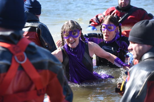 """The Storm"" team members Linda McCue, left to right, and Nathalie Stephens take the plunge during the Alzheimer's Association Hudson Valley Chapter's ninth annual Subzero Heroes ice jump Feb. 9."