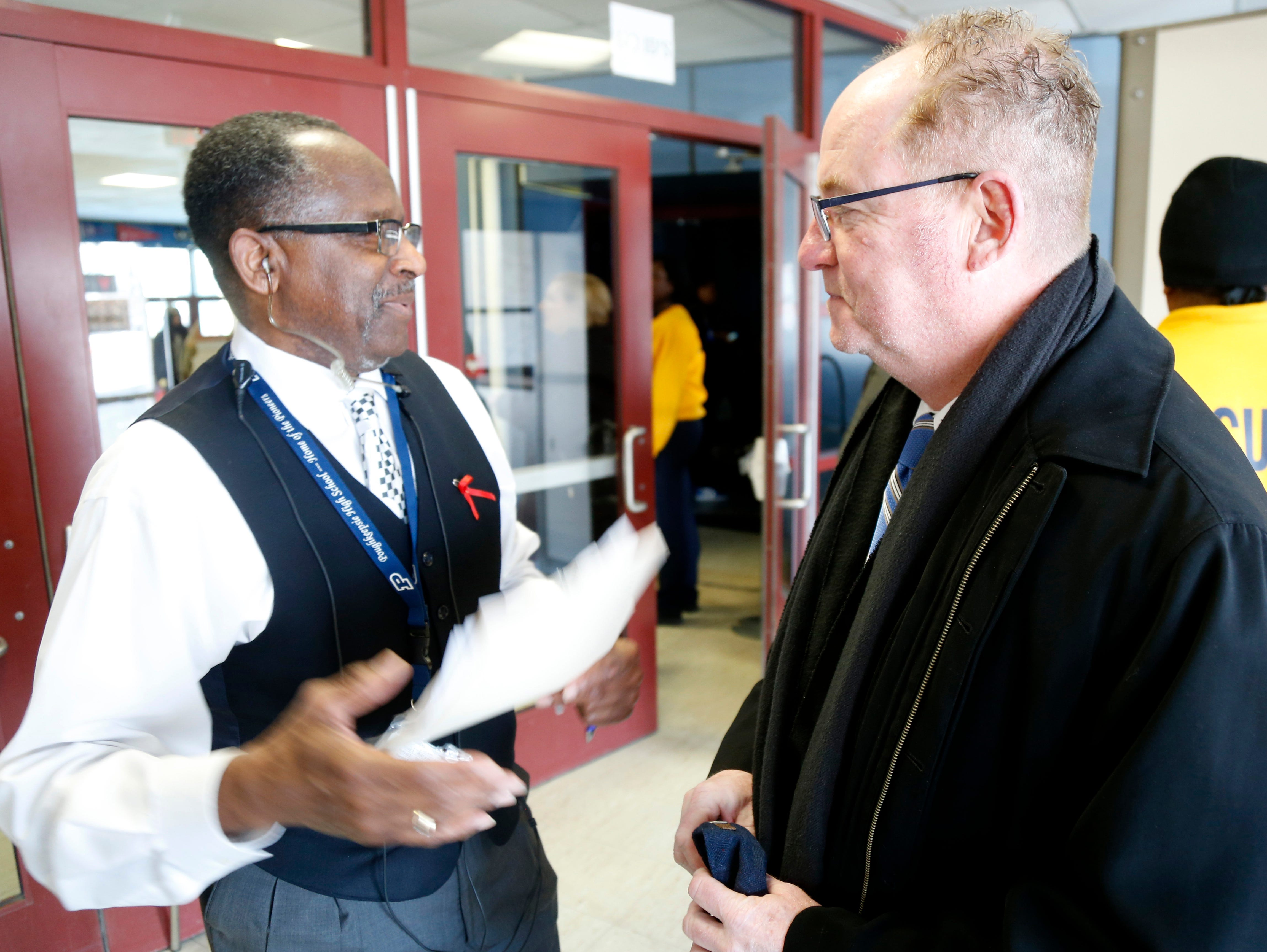 Prior to the start of Thursday's Martin Luther King Celebration at Poughkeepsie High School, principal Ronald Jackson talks with Mayor Rob Rolison on February 14, 2019.