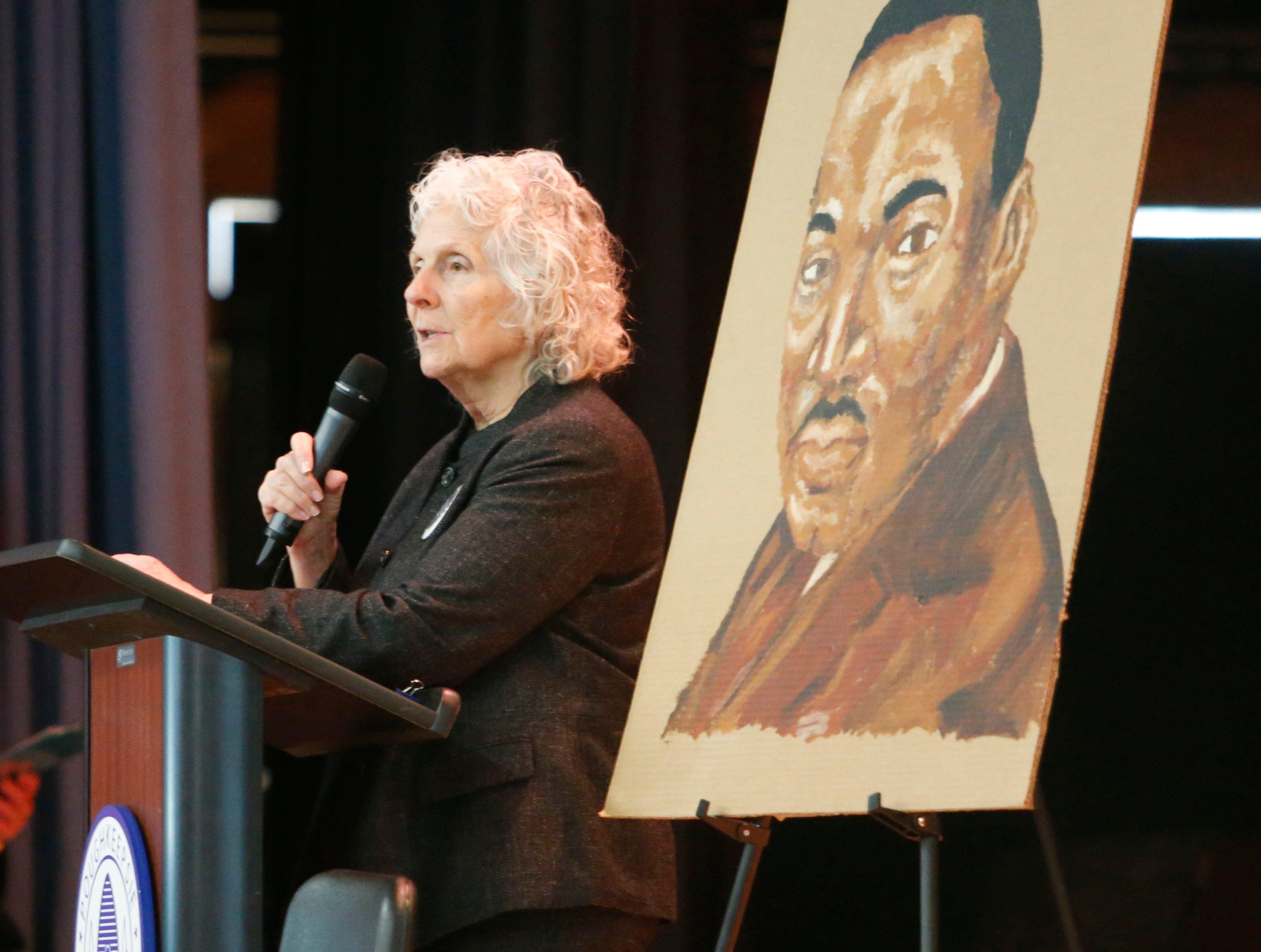 Poughkeepsie City School District interim superintendent, Kathleen Farrell speaks during Thursday's Martin Luther King Celebration at Poughkeepsie High School on February 14, 2019.