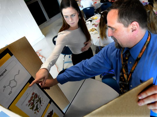 Central York High School senior McKenna Johnston and chemistry professor Matt Williams check one of the displays during the International Union of Pure and Applied Chemistry Global Breakfast at Central High School Thursday, Feb. 14, 2019. The event coincided with celebrations of the International Year of the Periodic Table around the world. Female students invited from all York County school districts attended the program with STEM-involved professional women with the goal of sharing information and inspiring young women to pursue careers in the field. The Periodic Table was first outlined by Russian chemist Dmitrii Mendeleev in 1869. Bill Kalina photo