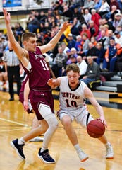 Central York's Evan Eisenhart, right, works to get around New Oxford's Brayden Long during York-Adams League boys' basketball semifinal game action at Red Lion Area High School in Red Lion, Wednesday, Feb. 13, 2019. New Oxford would win the game 43-41. Dawn J. Sagert photo