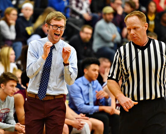 New Oxford head coach Sean Bair pleads with an official during the Colonials' 43-41 win over Central on Wednesday. Dawn J. Sagert photo