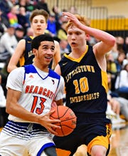 York High's Dayvon Cortez drives to the hoop in the Bearcats' win over Littlestown on Wednesday. Dawn J. Sagert photo