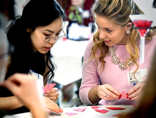 Red Lion High School seniors Sandar Phan, left, and Kayleigh Deisley play a periodic table game during the International Union of Pure and Applied Chemistry Global Breakfast at Central High School Thursday, Feb. 14, 2019. The event coincided with celebrations of the International Year of the Periodic Table around the world. Female students invited from all York County school districts attended the program with STEM-involved professional women with the goal of sharing information and inspiring young women to pursue careers in the field. The Periodic Table was first outlined by Russian chemist Dmitrii Mendeleev in 1869. Bill Kalina photo