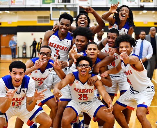 York High celebrates a 74-51 win over Littlestown during York-Adams League boys' basketball semifinal game action at Red Lion Area High School in Red Lion, Wednesday, Feb. 13, 2019. Dawn J. Sagert photo