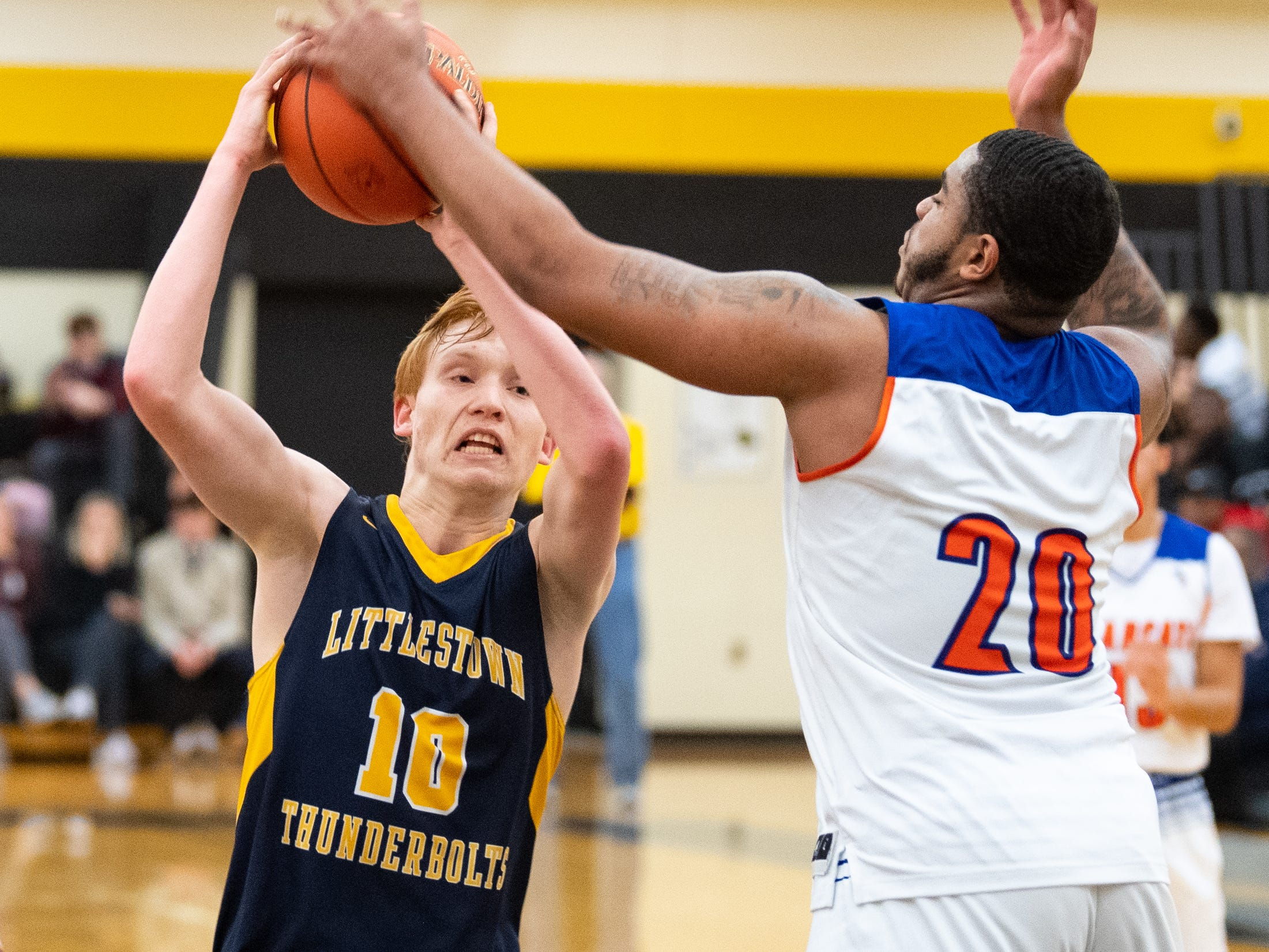 Littlestown's Dan Gazemen (10) is blocked by Marquise McClean (20) of York High during the YAIAA boys' basketball semifinals between York High and Littlestown, Wednesday, February 13, 2019 at Red Lion Area High School. The Bearcats defeated the Thunderbolts 74 to 51.