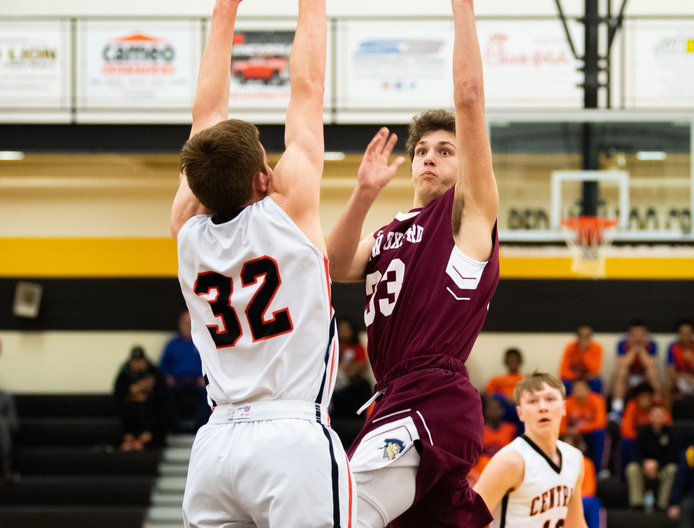 Connor Jenkins (33) takes the contested layup during the YAIAA boys' basketball semifinals between Central York and New Oxford, Wednesday, February 13, 2019 at Red Lion Area High School. The Colonials defeated the Panthers 43 to 41.