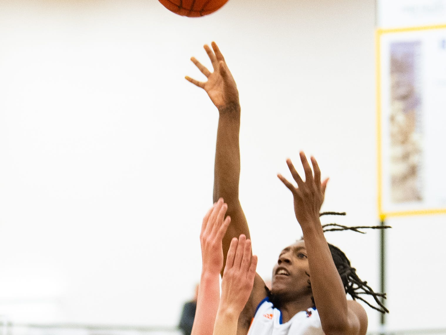 Edward Minter (5) rises up during the YAIAA boys' basketball semifinals between York High and Littlestown, Wednesday, February 13, 2019 at Red Lion Area High School. The Bearcats defeated the Thunderbolts 74 to 51.