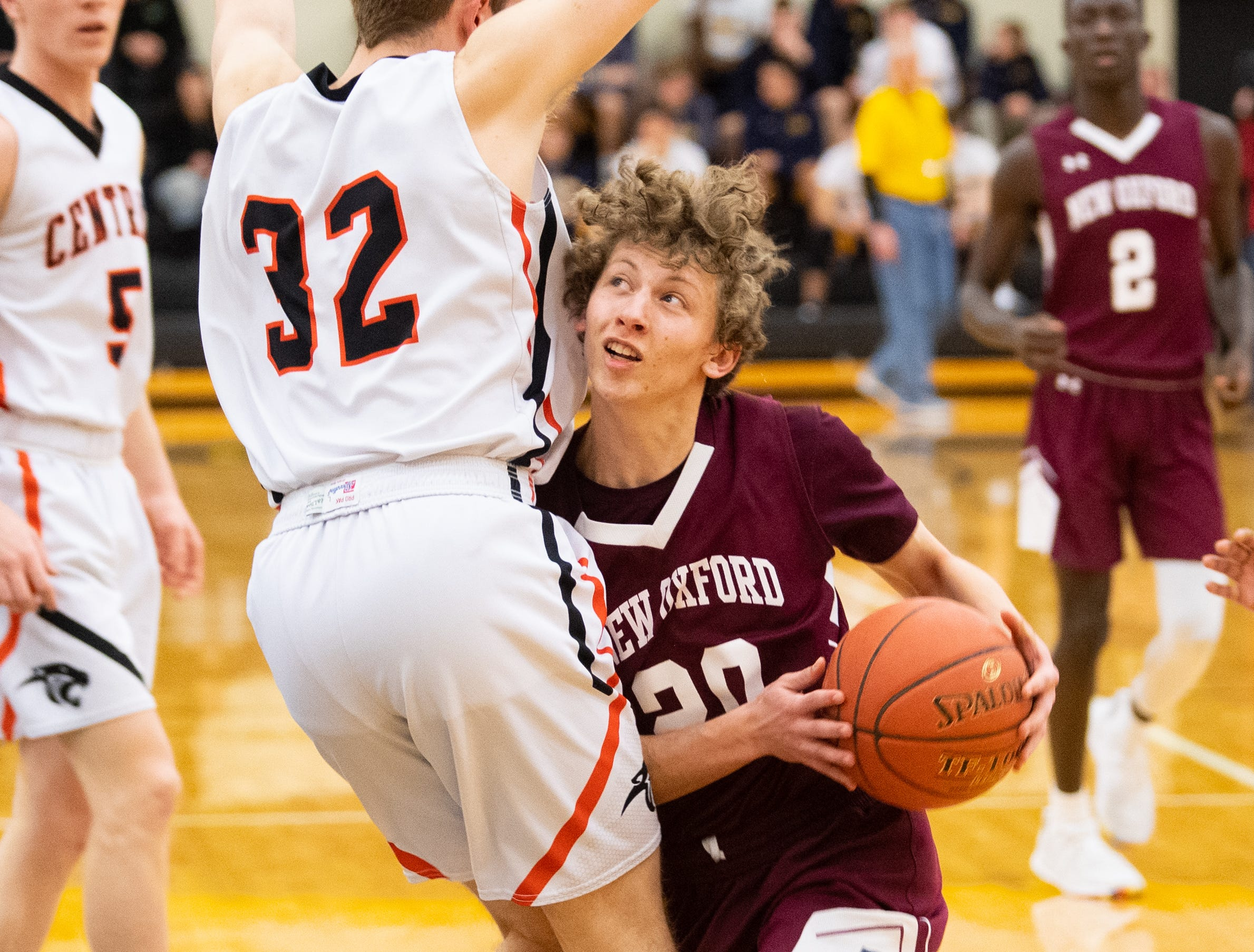 Jaren Rex (20) tries to draw the foul during the YAIAA boys' basketball semifinals between Central York and New Oxford, Wednesday, February 13, 2019 at Red Lion Area High School. The Colonials defeated the Panthers 43 to 41.