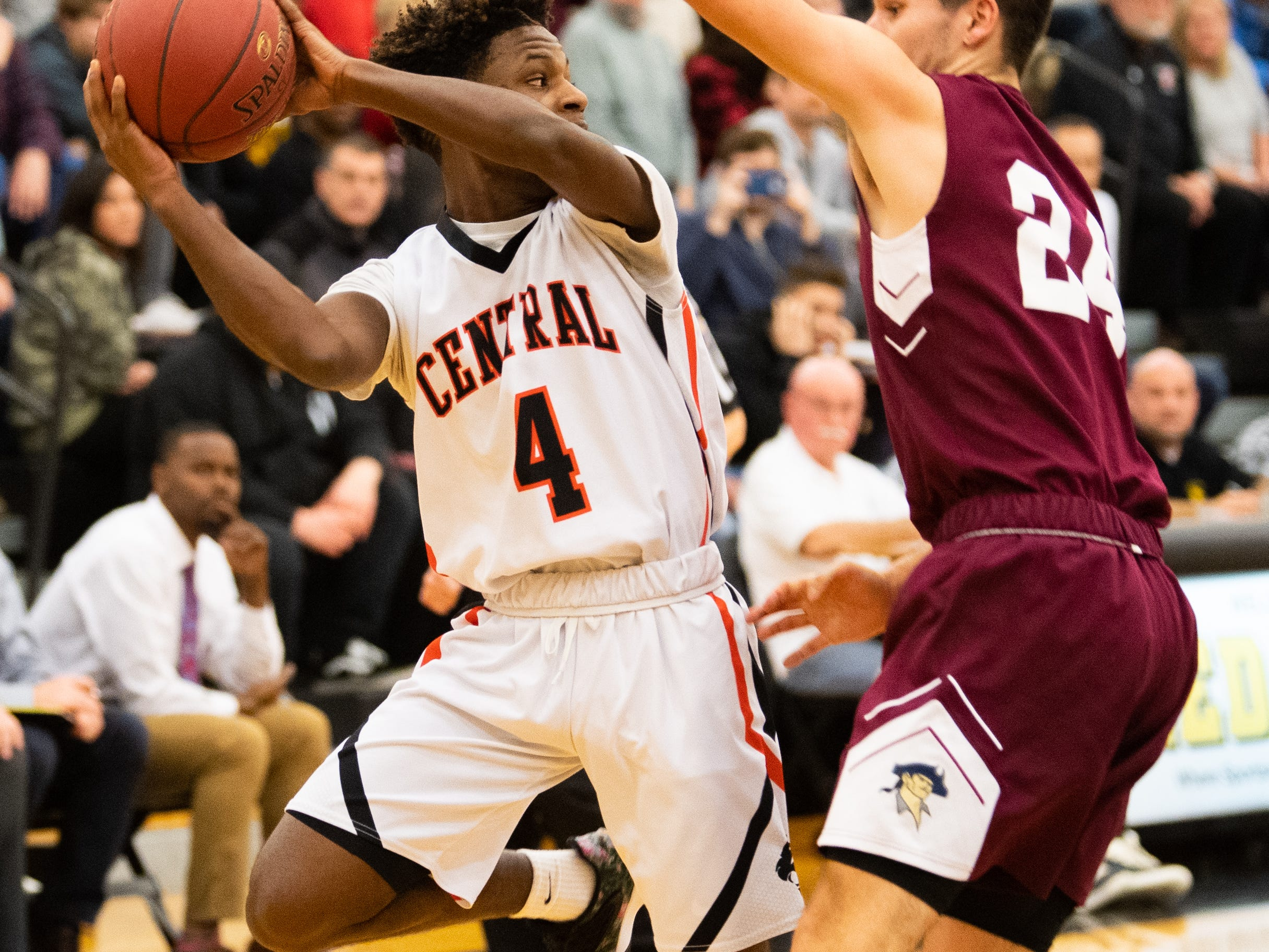 Saqhir Cornelius (4) saves the ball during the YAIAA boys' basketball semifinals between Central York and New Oxford, Wednesday, February 13, 2019 at Red Lion Area High School. The Colonials defeated the Panthers 43 to 41.