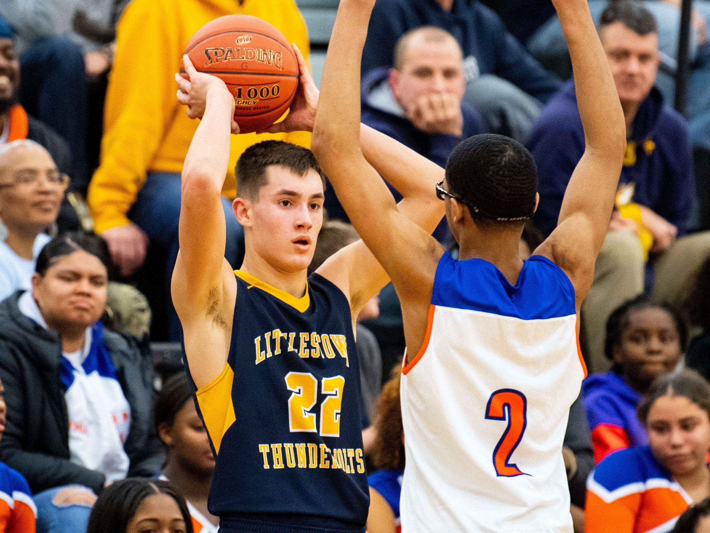 Logan Collins (22) passes the ball in during the YAIAA boys' basketball semifinals between York High and Littlestown, Wednesday, February 13, 2019 at Red Lion Area High School. The Bearcats defeated the Thunderbolts 74 to 51.