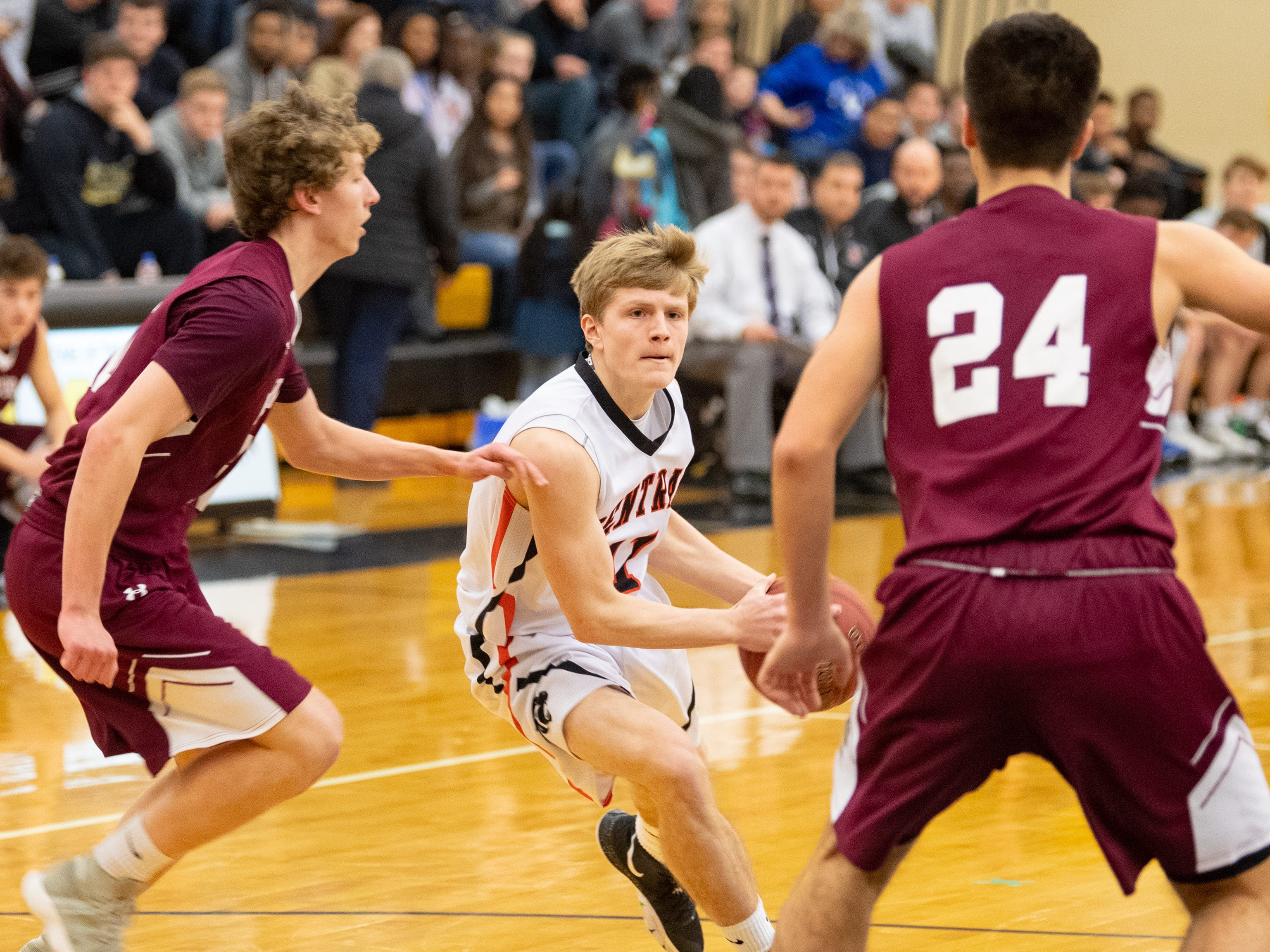 Nolan Hubbs (11) drives through the opening in the defense during the YAIAA boys' basketball semifinals between Central York and New Oxford, Wednesday, February 13, 2019 at Red Lion Area High School. The Colonials defeated the Panthers 43 to 41.