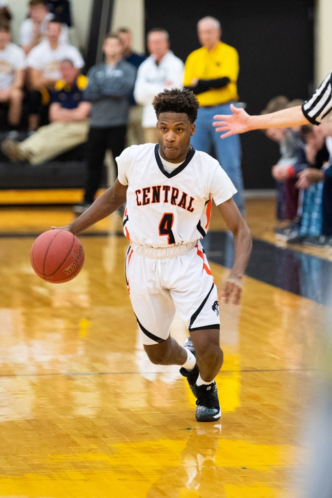 Saqhir Cornelius (4) brings up the ball during the YAIAA boys' basketball semifinals between Central York and New Oxford, Wednesday, February 13, 2019 at Red Lion Area High School. The Colonials defeated the Panthers 43 to 41.