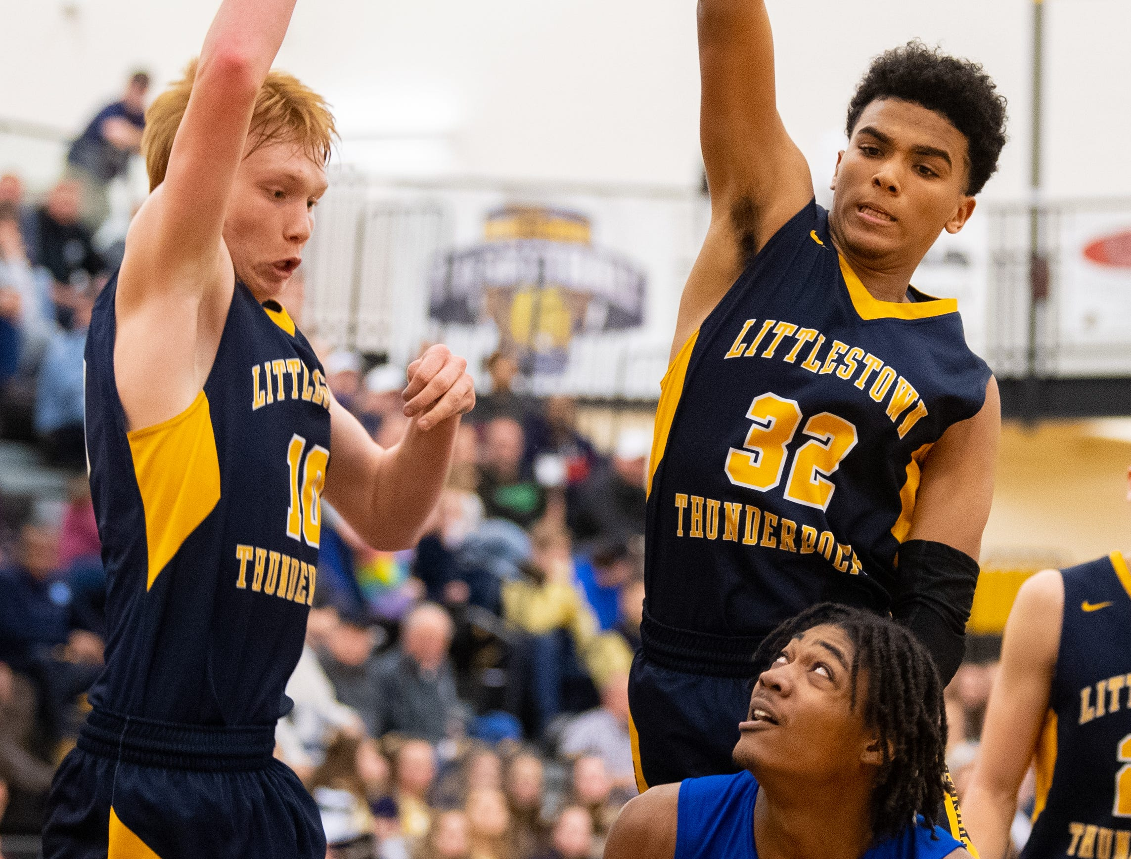 Littlestown's Dan Gazemen (10) and Jayden Weishaar (32) attempt to block Branden Mutunga (11) of York High during the YAIAA boys' basketball semifinals, Wednesday, February 13, 2019 at Red Lion Area High School. The Bearcats defeated the Thunderbolts 74 to 51.