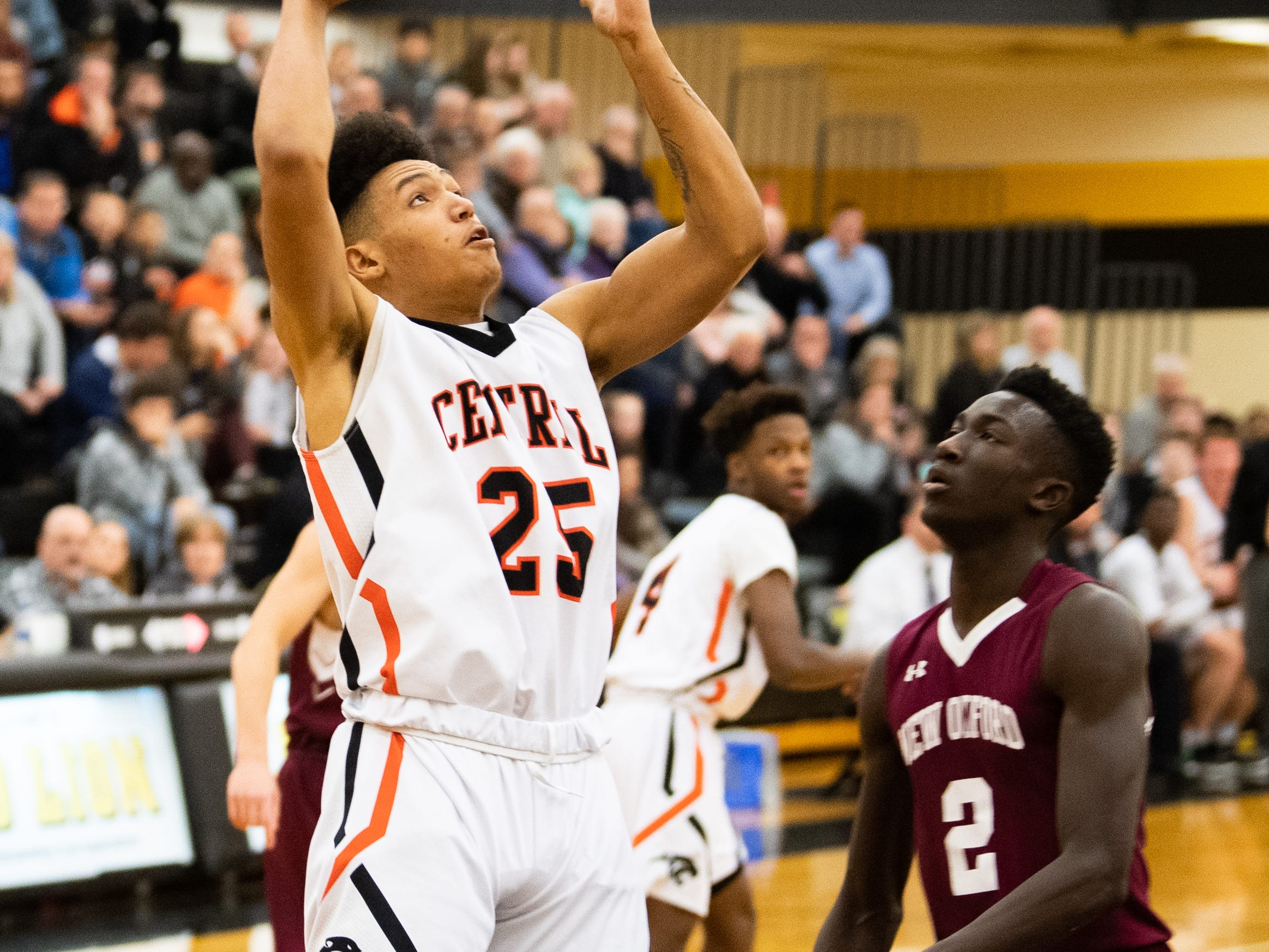 Tyquez McMillan (25) tries to score during the YAIAA boys' basketball semifinals between Central York and New Oxford, Wednesday, February 13, 2019 at Red Lion Area High School. The Colonials defeated the Panthers 43 to 41.