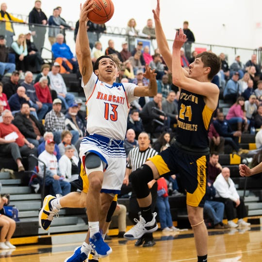 Dayvon Cortez (13) lays the ball up in traffic during the YAIAA boys' basketball semifinals between York High and Littlestown, Wednesday, February 13, 2019 at Red Lion Area High School. The Bearcats defeated the Thunderbolts 74 to 51.