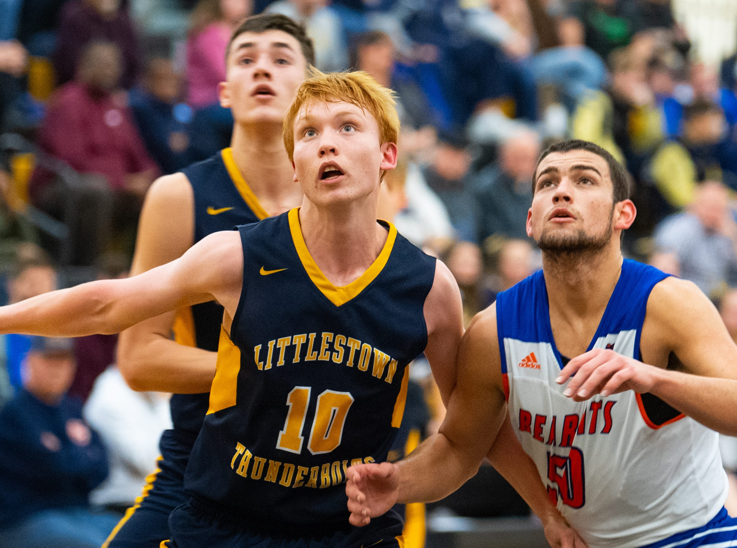 Littlestown's Dan Gazemen (10) and York High's Seth Bernstein (50) fight for position during the YAIAA boys' basketball semifinals between York High and Littlestown, Wednesday, February 13, 2019 at Red Lion Area High School. The Bearcats defeated the Thunderbolts 74 to 51.