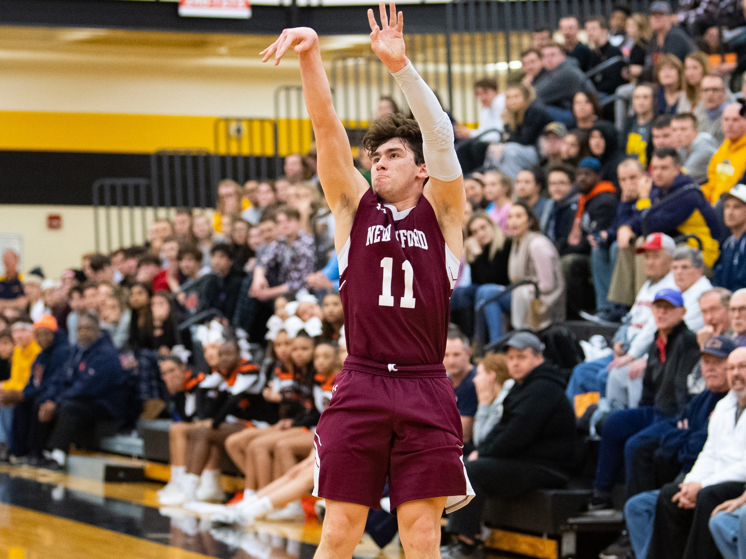 Noah Strausbaugh (11) takes the open shot during the YAIAA boys' basketball semifinals between Central York and New Oxford, Wednesday, February 13, 2019 at Red Lion Area High School. The Colonials defeated the Panthers 43 to 41.
