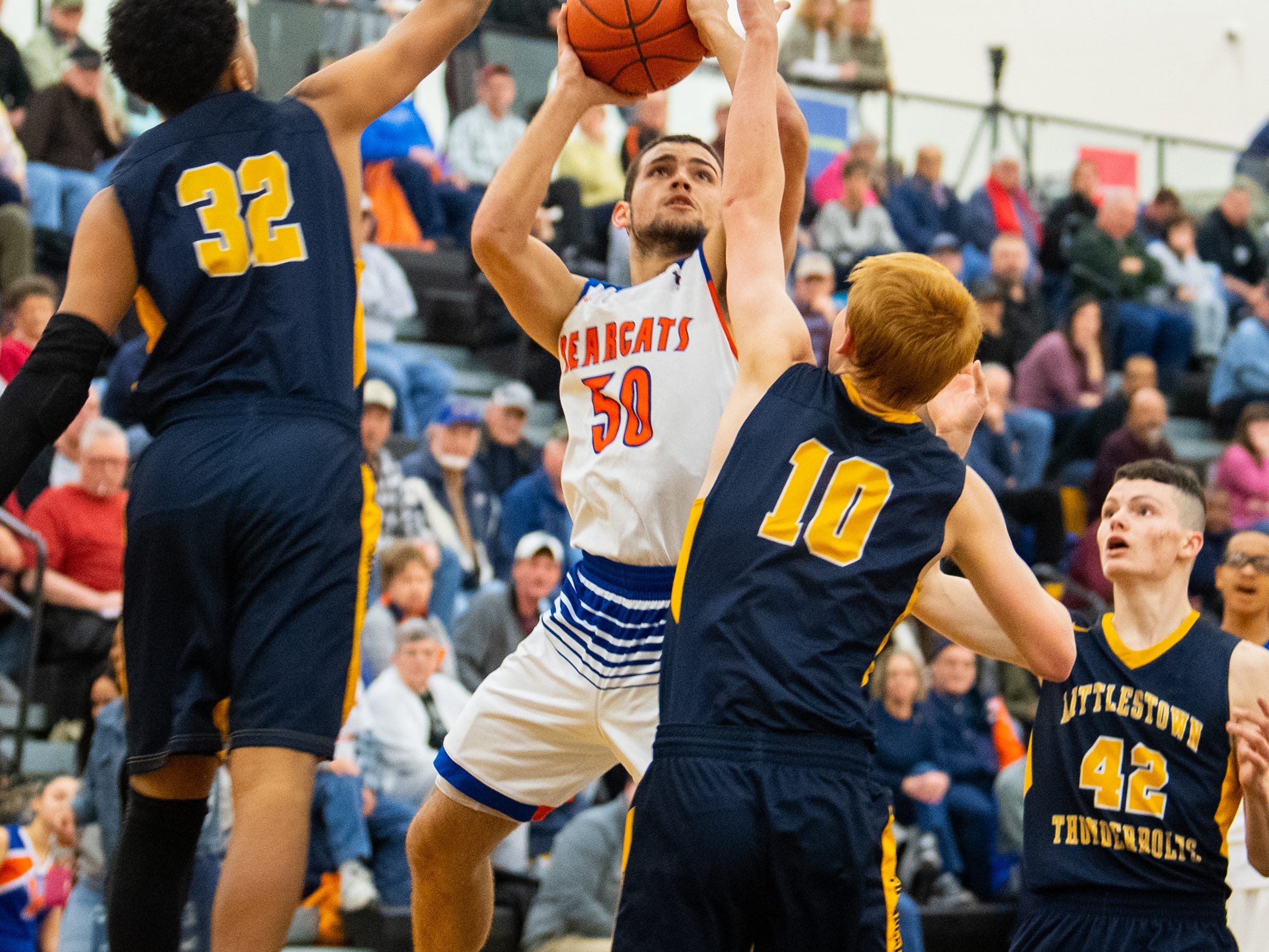 Seth Bernstein (50) looks to get a shot off during the YAIAA boys' basketball semifinals between York High and Littlestown, Wednesday, February 13, 2019 at Red Lion Area High School. The Bearcats defeated the Thunderbolts 74 to 51.