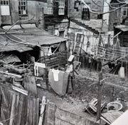 A man stands in a backyard to the rear East Charles Lane in York. This photo shows the poor living conditions that many black city residents complained about for several years leading up to the riots. Their cries for help were largely ignored and unanswered by city leadership in the 1950s, 60s and 70s.