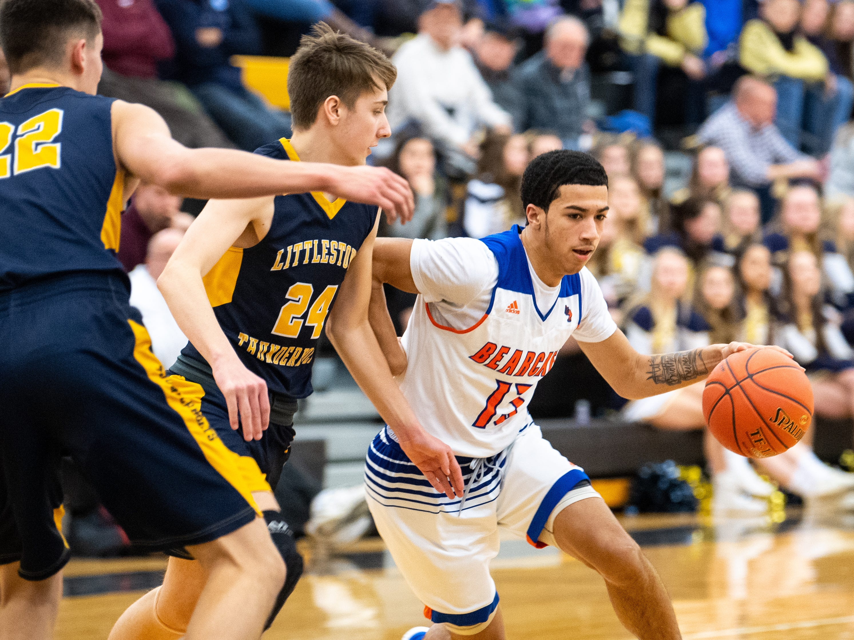 Dayvon Cortez (13) looks to get past the defense during the YAIAA boys' basketball semifinals between York High and Littlestown, Wednesday, February 13, 2019 at Red Lion Area High School. The Bearcats defeated the Thunderbolts 74 to 51.