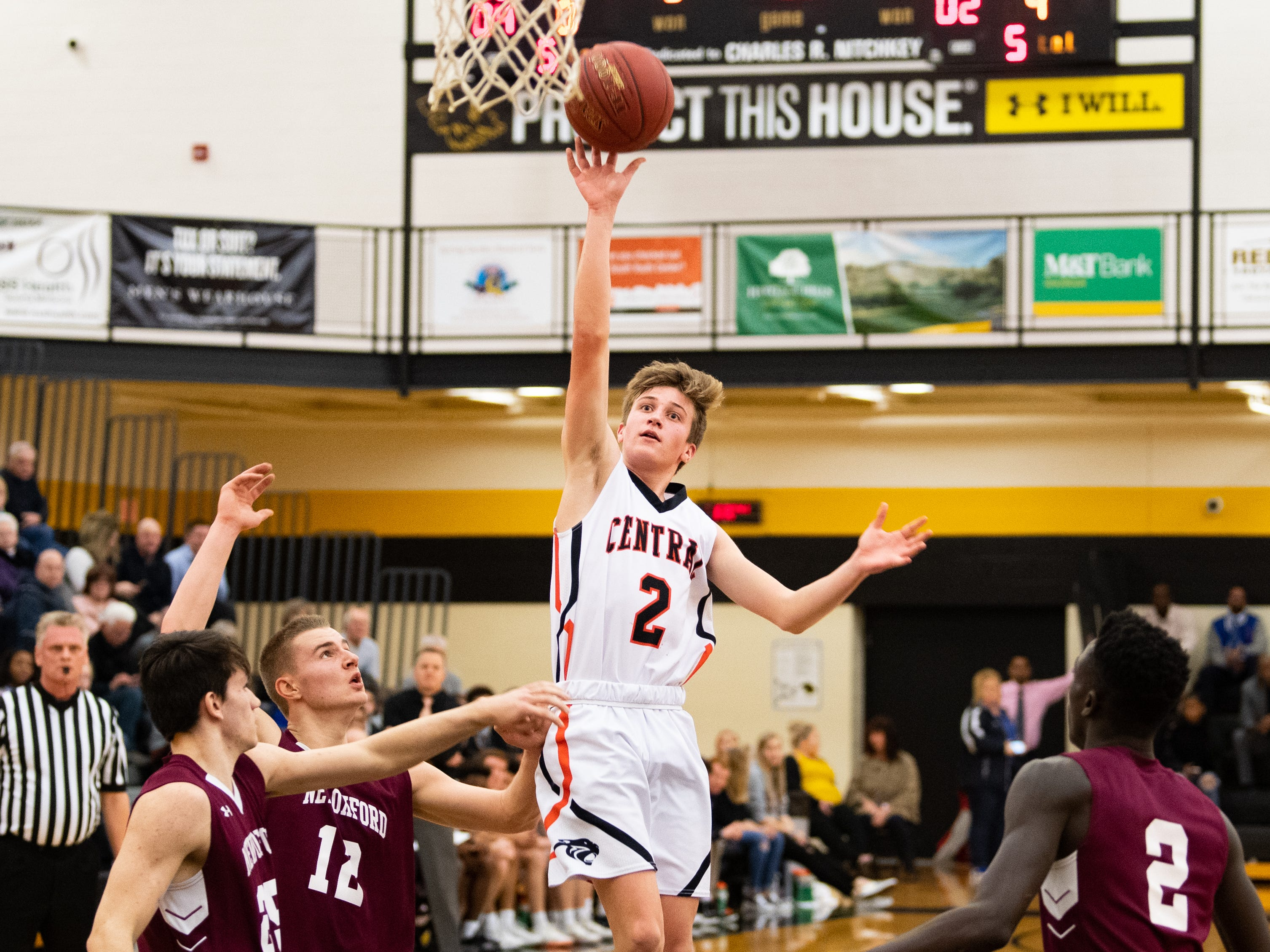 Alex Salter (2) throws up the floater during the YAIAA boys' basketball semifinals between Central York and New Oxford, Wednesday, February 13, 2019 at Red Lion Area High School. The Colonials defeated the Panthers 43 to 41.