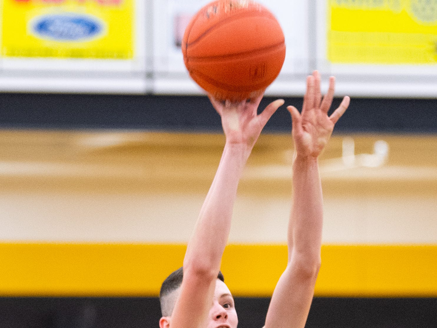 Brayden Staub (42) shoots a foul shot during the YAIAA boys' basketball semifinals between York High and Littlestown, Wednesday, February 13, 2019 at Red Lion Area High School. The Bearcats defeated the Thunderbolts 74 to 51.