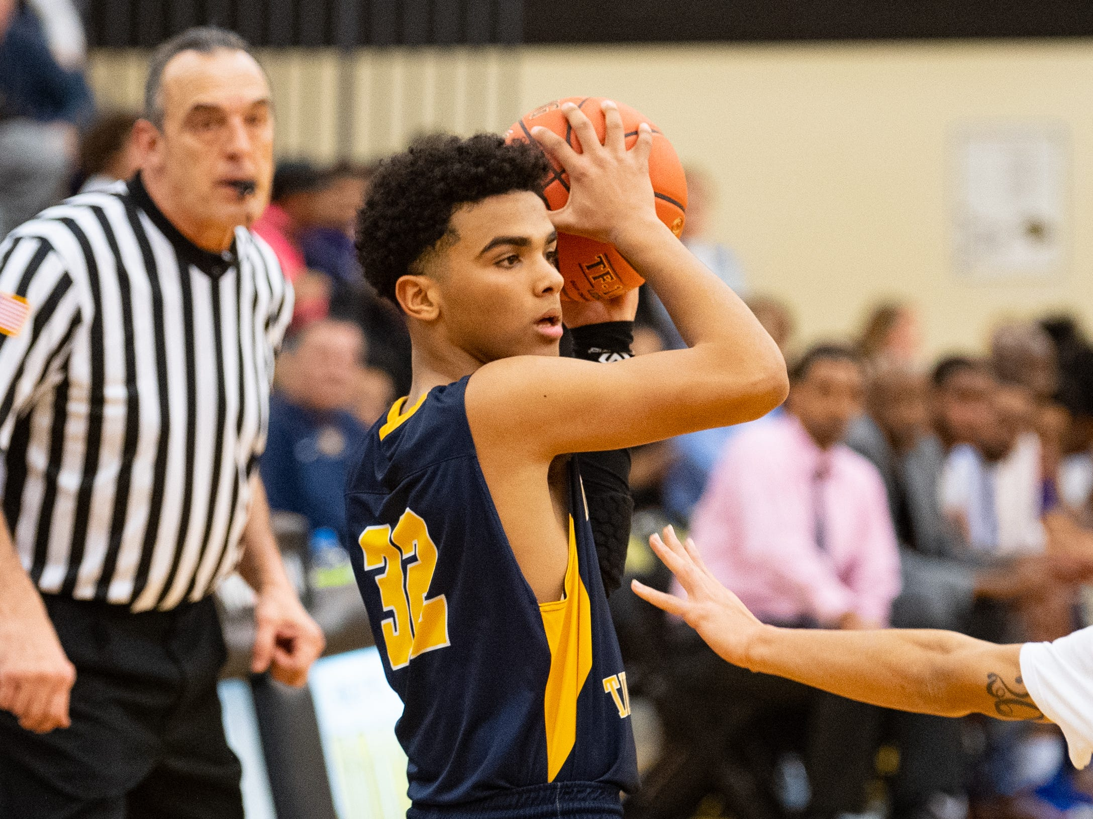 Jayden Weishaar (32) protects the ball during the YAIAA boys' basketball semifinals between York High and Littlestown, Wednesday, February 13, 2019 at Red Lion Area High School. The Bearcats defeated the Thunderbolts 74 to 51.