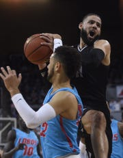 Nevada's Cody Martin fights through traffic while taking on New Mexico at Lawlor Events Center in Reno on Feb. 9, 2019.