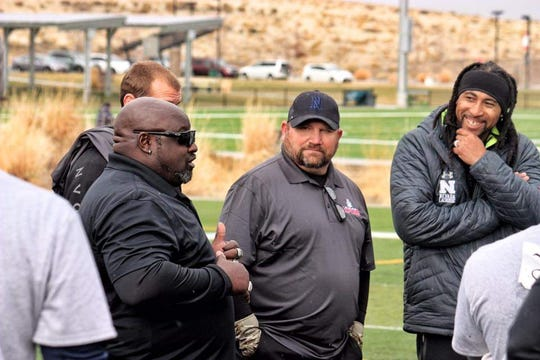 Anthony Bartley talks to coaches at tryouts for the Reno Express professional indoor football team last month at Golden Eagle sports complex in Sparks.