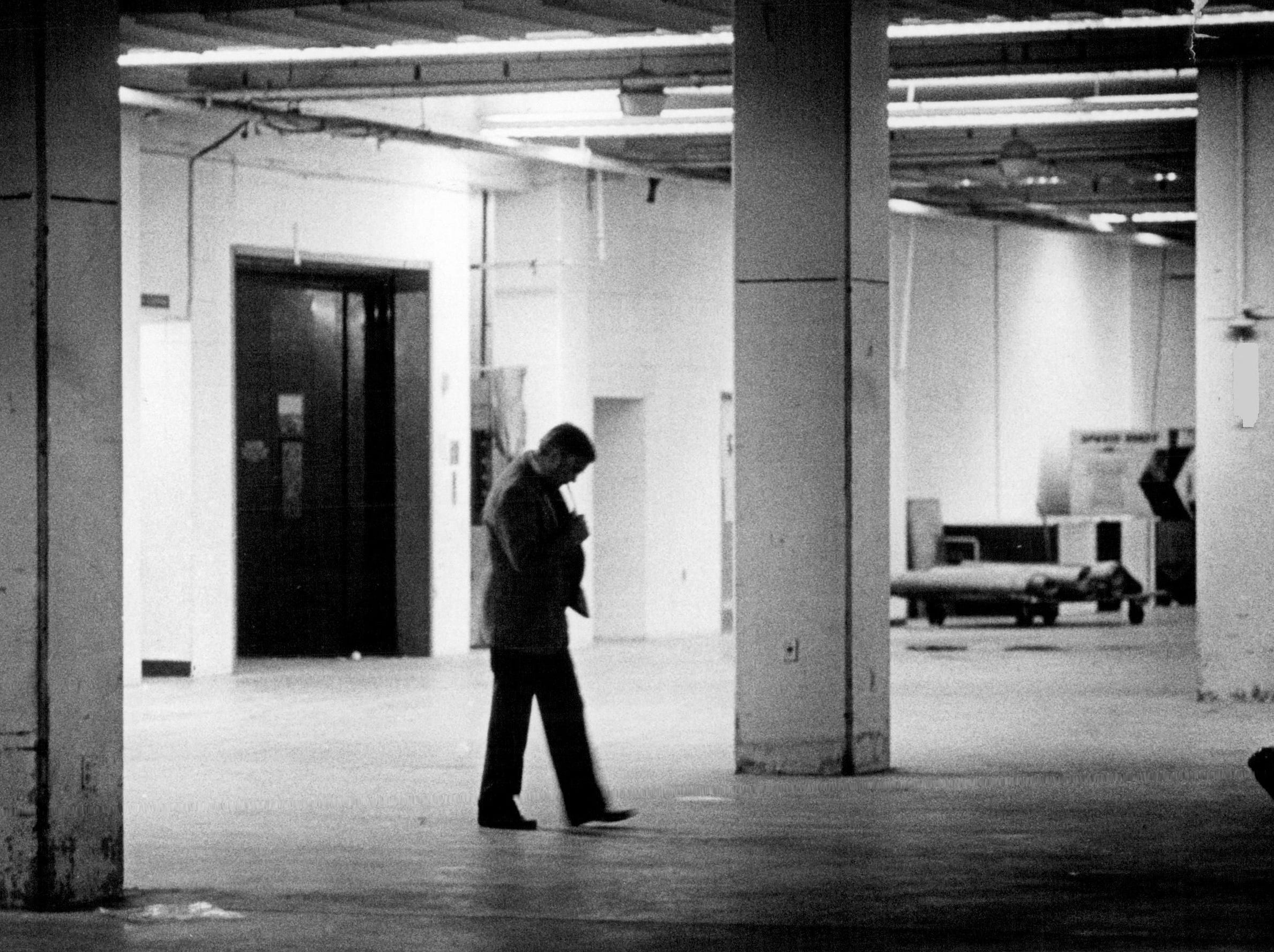 Joe Crozier paces quietly in the basement of a Baltimore parking garage following a loss in 1984.