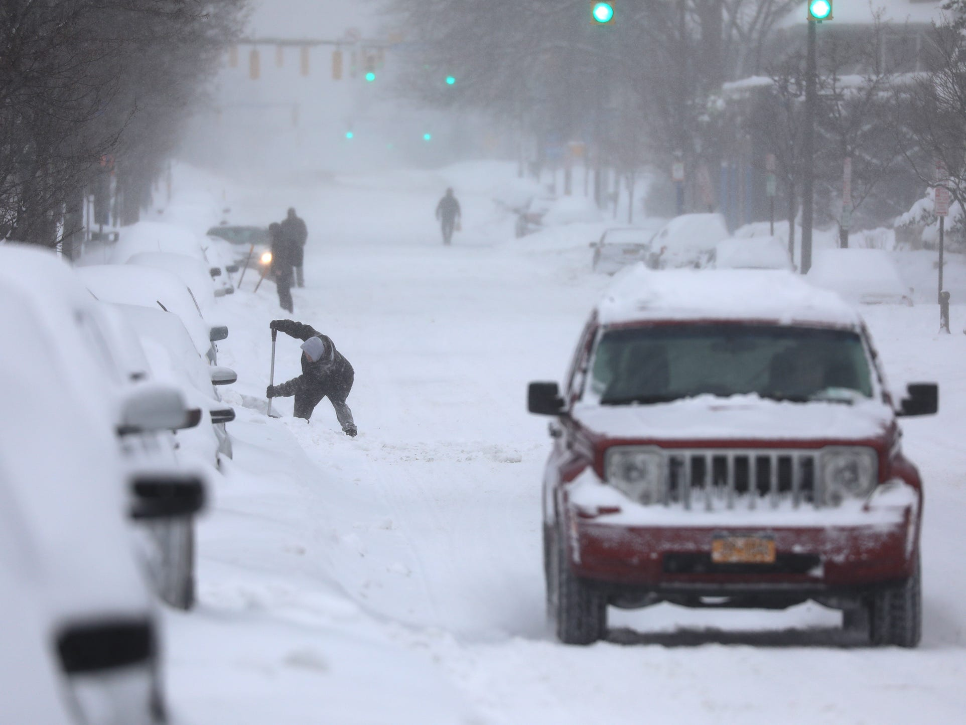 THE PHOTO:  Over a foot of snow fell overnight, with advisories issued about unnecessary travel and cold temperatures.  Many people heeded the warnings and stayed home, Sunday, Jan. 20, 2019.  FROM TINA:  Snow covered streets and cars with a person digging out their car made this a perfect snow storm shot.