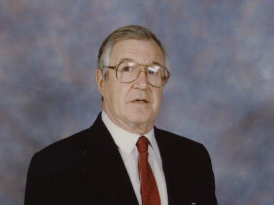 A formal portrait of former Rochester Americans coach Joe Crozier.
