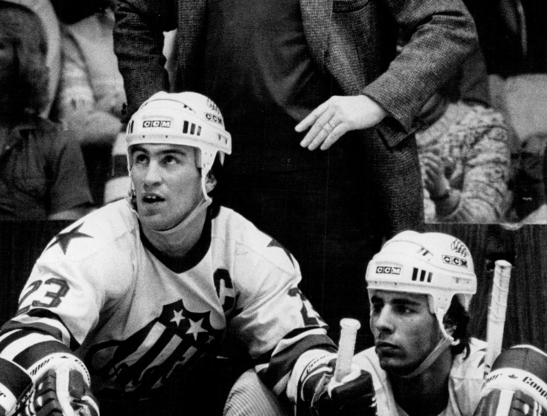 Rochester Americans coach Joe Crozier stands behind the bench during a game in 1984.